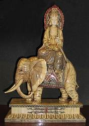 Carved and scrimshaw engraved elephant bone Kwanyin riding on Elephant with ivory detail (24 in. tall)- 19th century