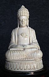 Fine Ceylonese Ivory Buddha seated in meditation posture or dhyana mudra (3 in. high) - early 20th C