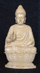 Extraordinary lifelike vintage Indian ivory Buddha - an unusual rendering of Ghanadaran style Shakyamuni Buddha seated in 'Gesture of Fearlessness' or 'blessing'  or abhaya mudra (7 in. tall) - early 20th C