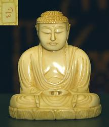 small Japanese ivory Buddha with wonderful golden patina (2 in. tall)