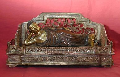 Reclining Buddha (a.k.a The Golden Lion) on intricate bed - masterfully cast in Bronze and gilt (12 in. long) - Qing Dynasty