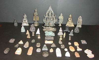 collection of small buddhas, buddha amulets and the like